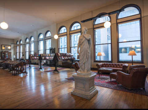 Interior of the Mercantile LIbrary with tall windows