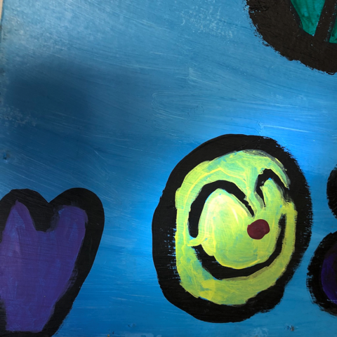 Painting of a yellow smiling face