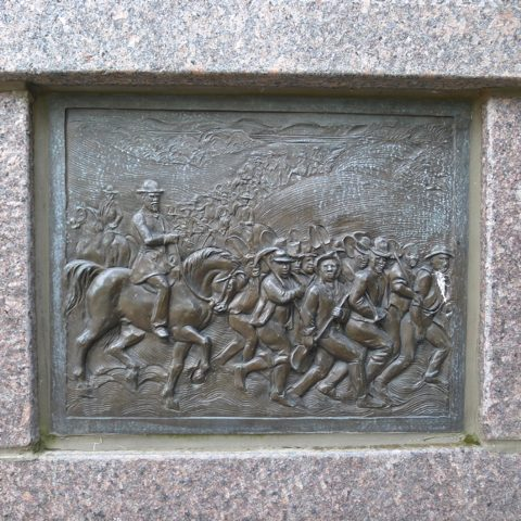 Panel from The Black Brigade memorial, showing The Black Brigade preparing to make fortifications