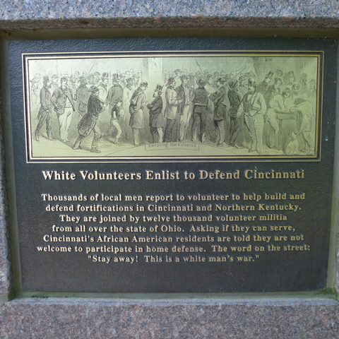 Panel from The Black Brigade memorial, showing white men enlisting