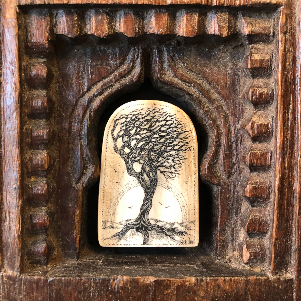 A tree carved on found whalebone, set in old wood