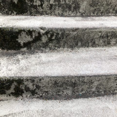 graphic image of light grey and dark stripes